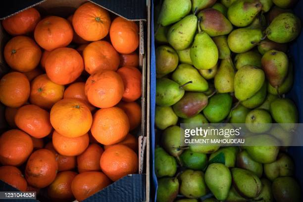 This photograph shows clementines and pears stored in the warehouse of ANDES NGO, in the professional wholesale food market of Marseille, southern...