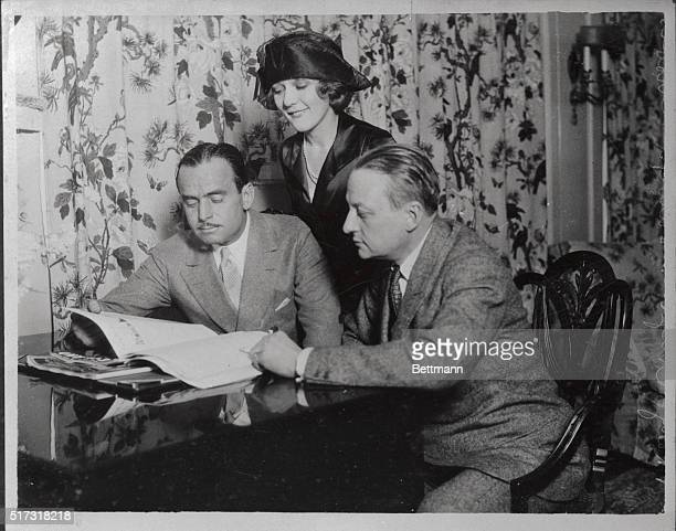 This photograph shows Douglas Fairbanks Sr Mary Pickford and Florenz Ziegfeld looking at a magazine