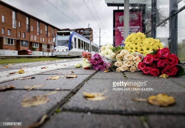 This photograph shows flowers on the platform of The Anthony Fokkersingel Tramway Station, in The Hague on October 19 following an accident in which...