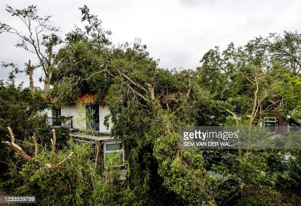 This photograph shows houses damaged in Leersum, in the Dutch municipality of Utrechtse Heuvelrug, in the province of Utrecht, on June 19 one day...