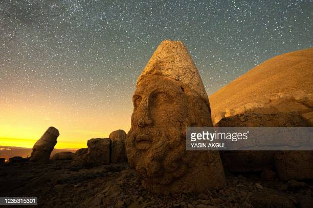 This photograph shows large stone head statues at the archaeological site of Mount Nemrut in Adiyaman, southeastern Turkey, on September 17, 2021. -...
