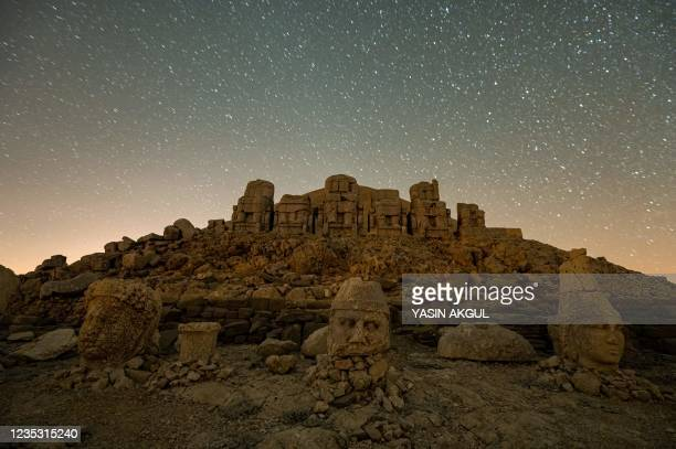 This photograph shows massive stone head statues at the archaeological site of Mount Nemrut in Adiyaman, southeastern Turkey, on September 17, 2021....