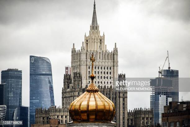 This photograph shows the Russian Foreign Ministry building and Moscow's International Business Centre behind the dome of a church in central Moscow...
