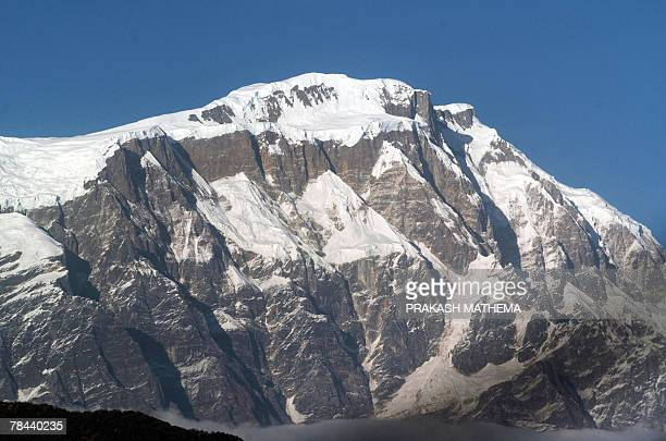 This photograph taken 04 December from an ultra light aircraft shows an aerial view of the Himalayan Mountains featuring Mount Annapurna south range...