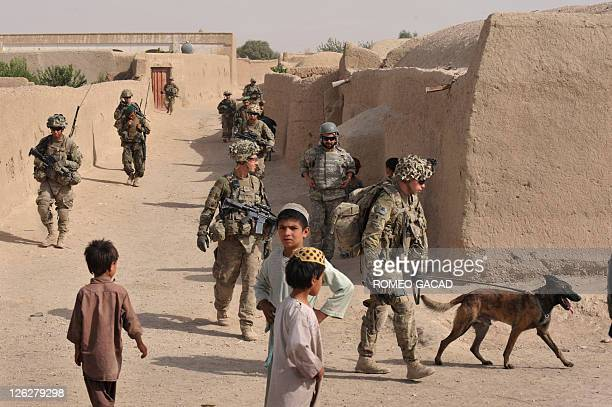 This photograph taken August 8 2011 shows US Army Specialist Justin Coletti of US Forces Afghanistan K9 combat tracker team and Dasty a Belgian...