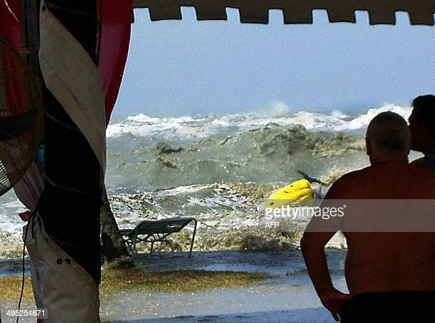 This photograph taken by tourist Eric Skitzi shows a tsunami wave hitting the beach of Batu Ferringhi on Penang island Malaysia 26 December 2004 The...