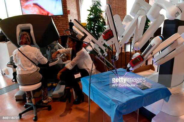 This photograph taken during the International Robotics Festival 2017 in Pisa on September 12 shows a person manipulating a 'Da Vinci' robot for...