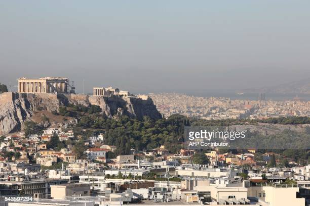 This photograph taken early September 7 shows a general view of The Acropolis in Athens. / AFP PHOTO / ludovic MARIN