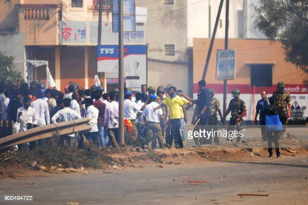 This photograph taken in January 1 shows Indian policemen taking positions as clashes broke up between two groups during celebrations to mark the...