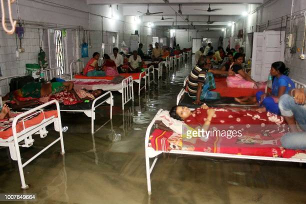This photograph taken in July 28 shows a patients and relatives in a waterlogged ward at Nalanda Medical College and Hospital following heavy monsoon...