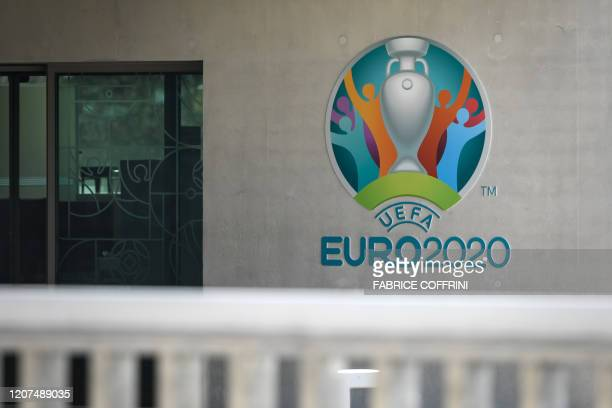 This photograph taken in Nyon on March 17 shows the Euro 2020 logo at the headquarters of UEFA the European football's governing body amid spread of...