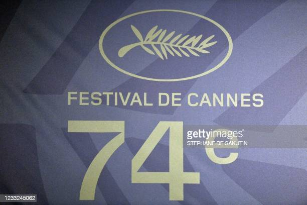 This photograph taken in Paris on June 3, 2021 shows the logo of the 74th Cannes Film Festival during a press conference, announcing the Official...