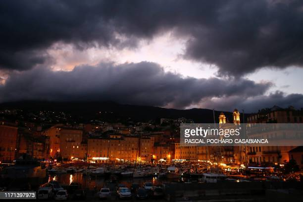 TOPSHOT This photograph taken late on September 26 shows a general view of the port of Bastia on the French Mediteranean Island of Corsica