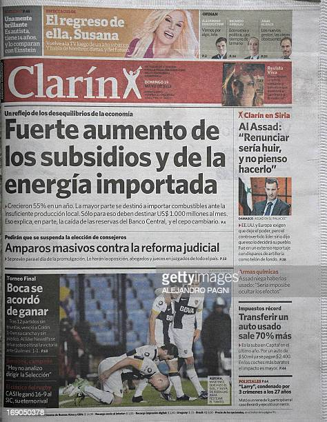 This photograph taken of the front page of the May 19 2013 edition of Argentine newspaper El Clarin in Buenos Aires shows an interview with Syrian...