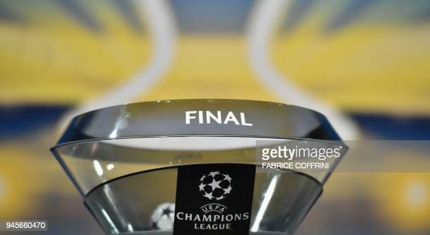 This photograph taken on April 13 shows the holder for the team names ahead of the draw for the semifinals round of the UEFA Champions League...