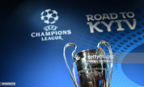 This photograph taken on April 13 shows the UEFA Champions League football cup ahead of the draw for the semifinals round of the UEFA Champions...
