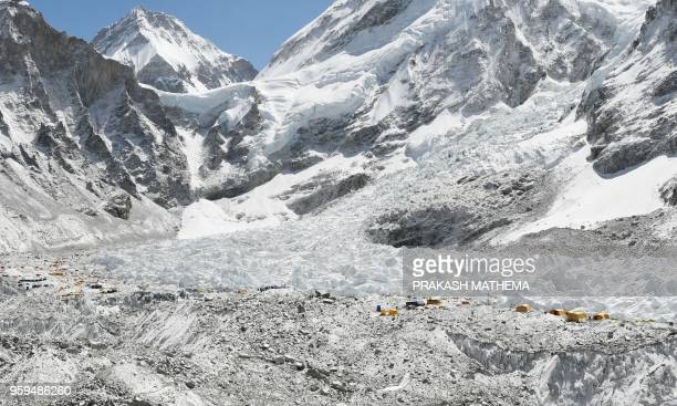 This photograph taken on April 26 shows the Khumbu glacier one of the longest glaciers in the world and the Everest base camp at the Everest region...