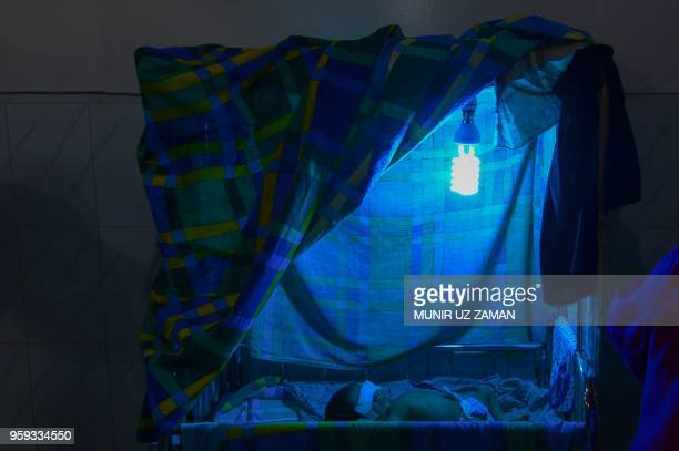 This photograph taken on April 9 shows a sick child being treated at a Doctors Without Borders clinic at Kutupalong refugee camp in Bangladesh's...