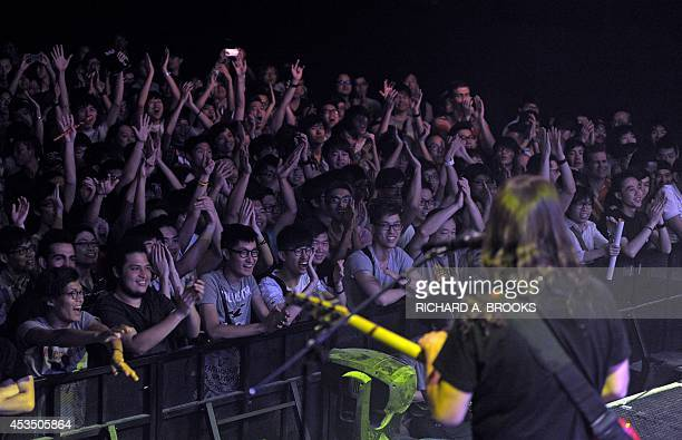 This photograph taken on August 11 shows fans cheering the band The Aristocrats as they perform in Hong Kong The jazzfusion oriented hard rock trio...