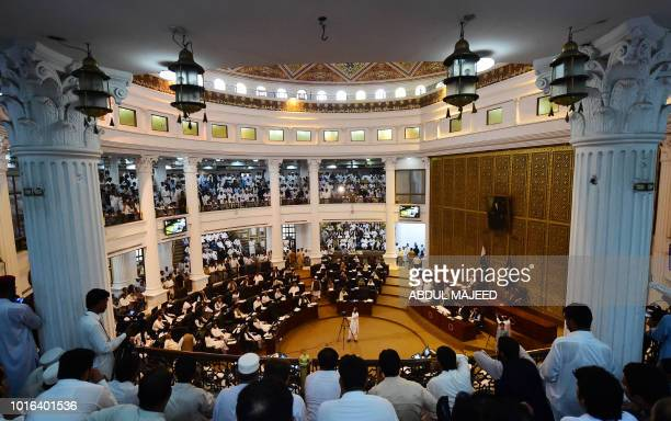 This photograph taken on August 13 2018 show Pakistani legislators taking oath during the first session of the provincial assembly after the July 25...