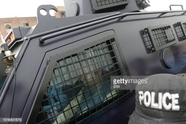This photograph taken on August 13 2018 shows former Pakistani prime minister Nawaz Sharif sitting in a armoured vehicle as he arrives to a...
