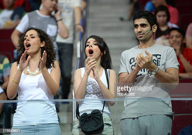This photograph taken on August 3 2013 shows Iranian basketball fans cheering their national team playing against China in the men's Asian...