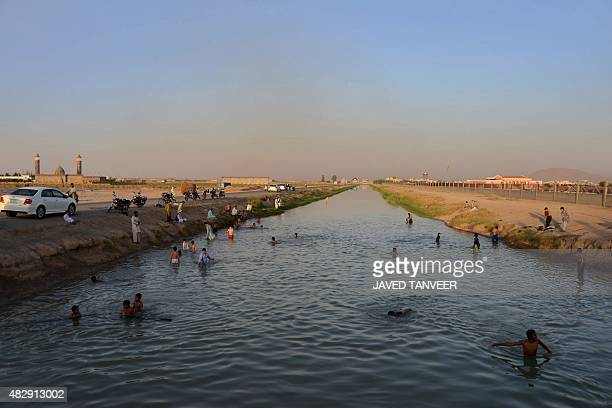 This photograph taken on August 3 shows Afghan youths swimming in the Zahir Shahi canal in Kandahar province AFP PHOTO / Javed Tanveer