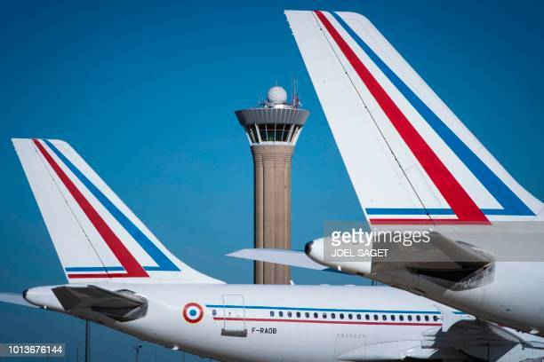 This photograph taken on August 6 shows a pair of French Air Force Airbus A310304 aircraft and the central control tower at RoissyCharles de Gaulle...