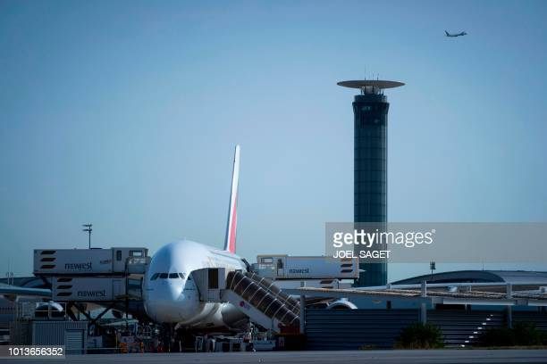 This photograph taken on August 7 shows an Air France Airbus A380 aircraft near the south control tower on the tarmac at RoissyCharles de Gaulle...
