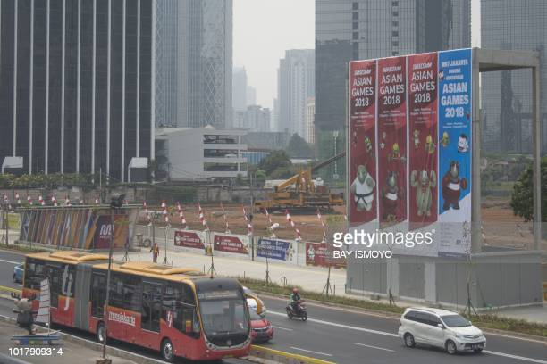 This photograph taken on August 8 2018 shows banners promoting the 2018 Asian Games as haze from air pollution is seen in Jakarta Indonesia is about...