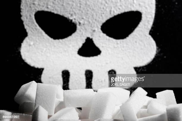 This photograph taken on December 19 shows a skull shape made of grains of sugar in Paris / AFP PHOTO / JOEL SAGET