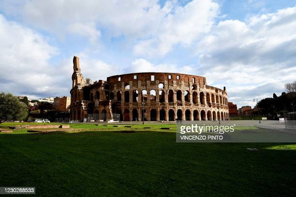 This photograph taken on December 24, 2020 shows the Rome's Colisseum empty square in central Rome, as Italy observes today new tight restrictions...