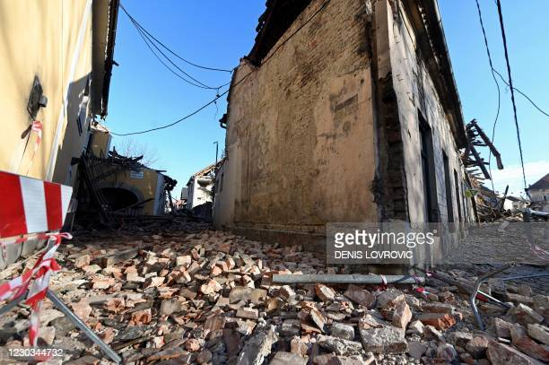 This photograph taken on December 29 shows damaged buildings in Petrinja, some 50kms from Zagreb, after the town was hit by an earthquake of the...