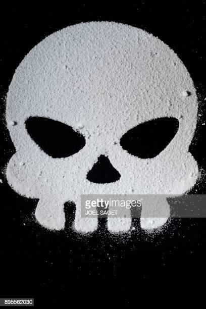 This photograph taken on December 5 shows a skull shape made of grains of sugar in Paris / AFP PHOTO / JOEL SAGET