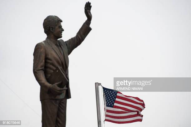 This photograph taken on February 11 shows a US flag flying next to the statue of former US president Bill Clinton in Pristina. - Kosovo, which...