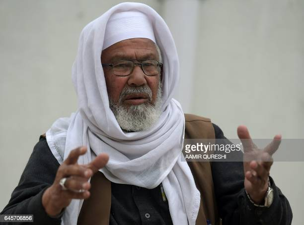 This photograph taken on February 15 2017 shows Malik Bashir Awan father of Mumtaz Qadri who was hanged last year for the murder of a governor who...