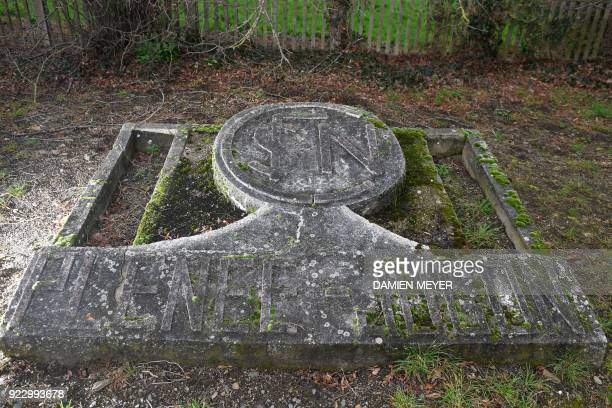 This photograph taken on February 20 shows an old concrete SNCF logo in the rail station of PlénéeJugon in western France A report by former Air...