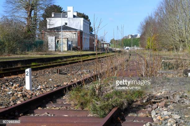 This photograph taken on February 20 shows rusting rail tracks at the railway station in Plancoët which are now occupied largely by an insurer A...