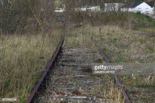 This photograph taken on February 20 shows rusting rail tracks near the railway station in Plancoët which are now occupied largely by an insurer A...