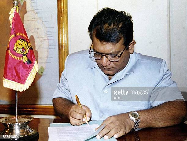 This photograph taken on February 20 shows Sri Lanka's top Tamil Tiger leader Velupillai Prabhakaran signing a historic ceasefire agreement in...