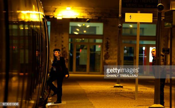 This photograph taken on February 22 shows a member of railways staff stepping into a carriage of a train at the train station at Le Tréport...