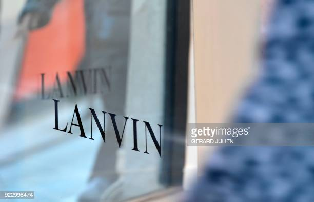 This photograph taken on February 22 shows details of mannequins and signs at a Lanvin shop on the Rue du Faubourg SaintHonore in Paris Chinese...