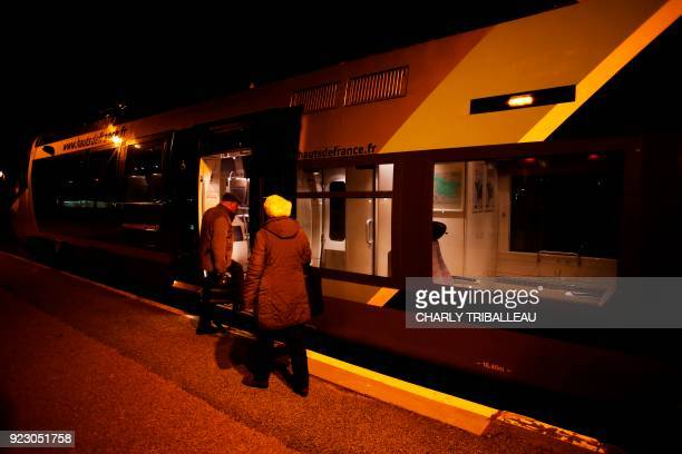 This photograph taken on February 22 shows passengers as they embark onto a train at the train station in Le Tréport northwestern France which is...