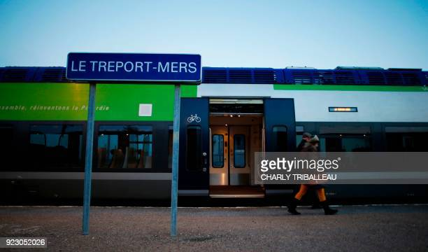 This photograph taken on February 22 shows passengers disembarking from a train at the train station at Le Tréport northwestern France which is...
