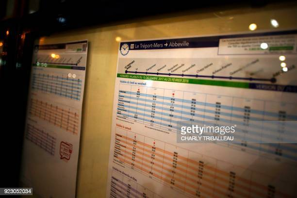 This photograph taken on February 22 shows the timetable at the train station at Le Tréport northwestern France which is served by the railway line...