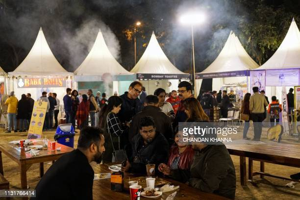 This photograph taken on February 24 2019 shows Indian patrons eating at an outdoor food court in Nehru Park in New Delhi For the wellheeled in New...