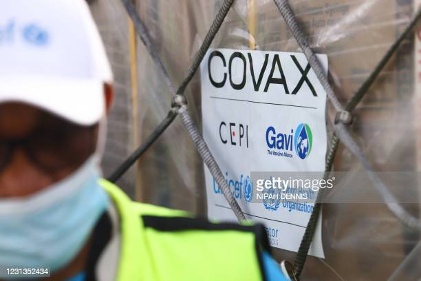 This photograph taken on February 24, 2021 shows a Covax tag on a shipment of Covid-19 vaccines from the Covax global Covid-19 vaccination programme,...