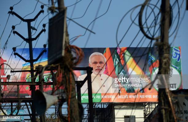 This photograph taken on February 28 shows a Bharatiya Janata Party election campaign hoarding displaying an image of Indian Prime Minister Narendra...