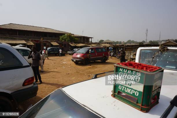 This photograph taken on February 3 shows a crate which rests on the roof of the minibus indicating its destination at Gboko bus station in the...