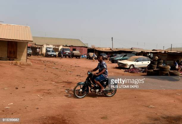 This photograph taken on February 3 shows a motorcyclist riding through Gboko Bus Station in the restive Benue State northcentral Nigeria In the...
